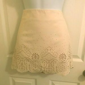 Ivory skirt with cut-out details!